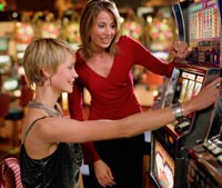 Girls playing slots together