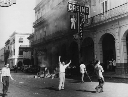 black and white of people looting and burning a casino circa 1948