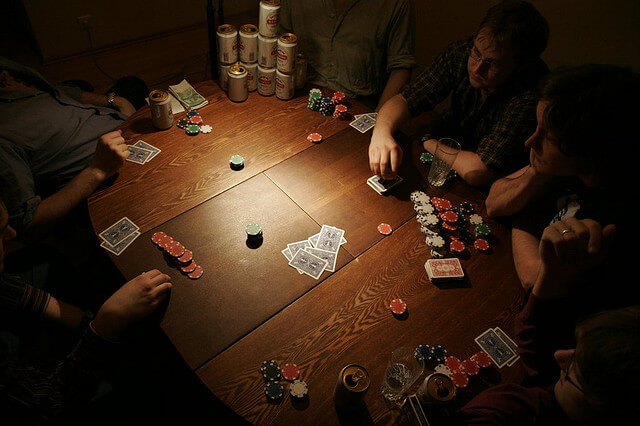 People playing 3 card poker at a table