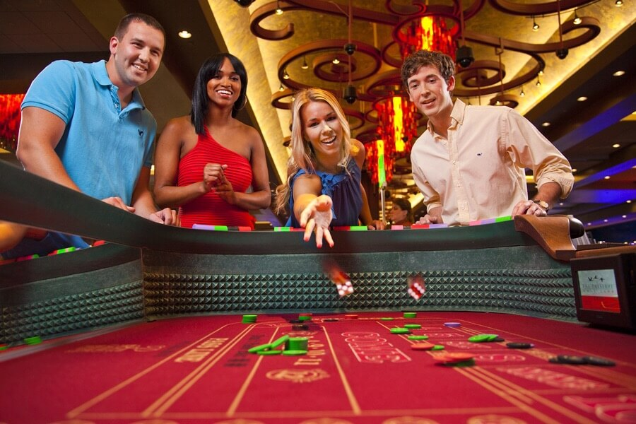 image of man and women playing the casino game of craps