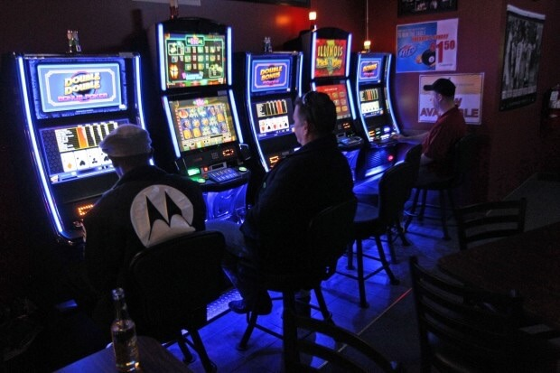 Casino expansion images of people playing slot machines