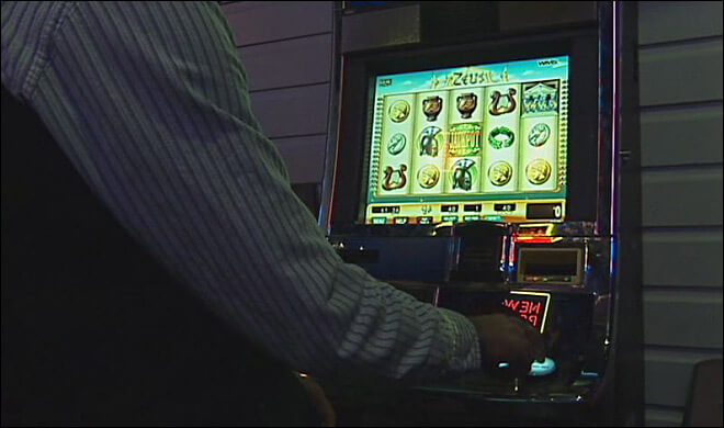 person playing a lotto slot game