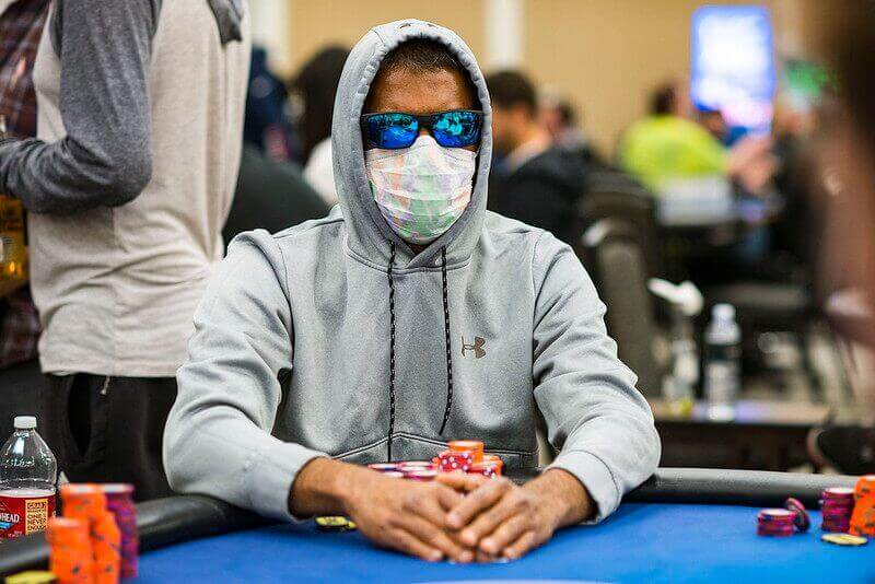 man playing poker with mask